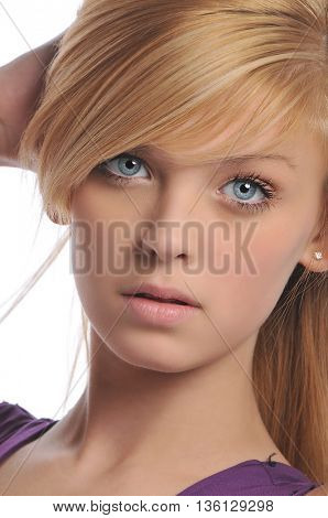 Portrait of young beautiful blond with blue eyes isolated on a white background