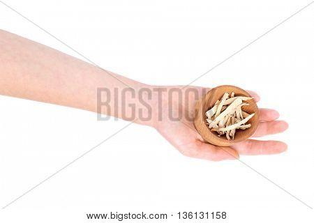 Hand holding wooden bowl with calamus (Acorus calamus) isolated on white