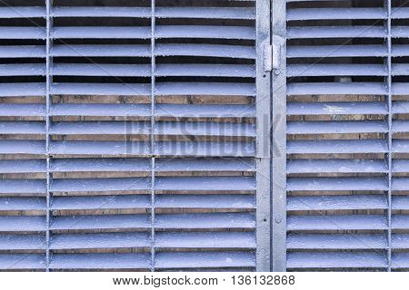 old corrugated texture of iron blinds of blue silvery color for a vintage background and for wallpaper