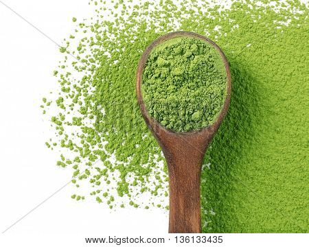 Wooden spoon with powdered matcha green tea, isolated on white