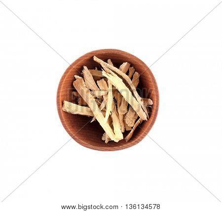 Calamus (Acorus calamus) in small wooden bowl isolated on white