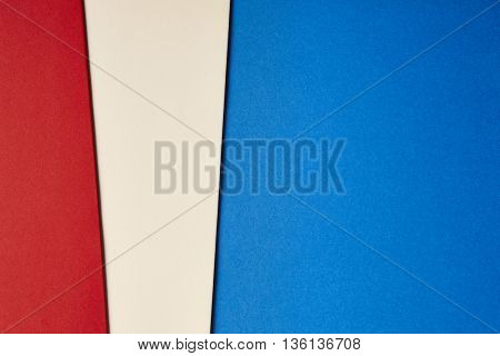 Colored cardboards background in blue beige red tone. Copy space. Horizontal