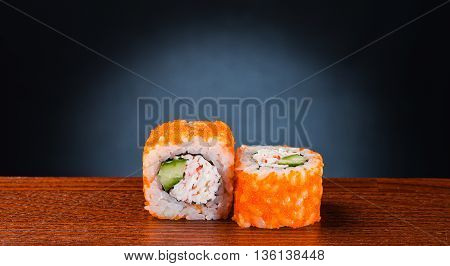 Tasty sushi roll with crab and avocado, traditional japanese food
