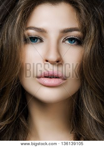 Portrait Of A Beautiful Young Woman With Perfect Skin Closeup On Gray Background