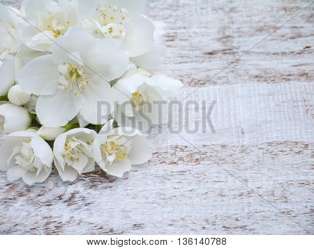White English dogwood flowers bouquet in the corner of the wooden rustic background