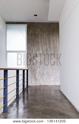 Architecture Design Of House, Passageway Cement Floor And White Wall With Baluster In Modern Room