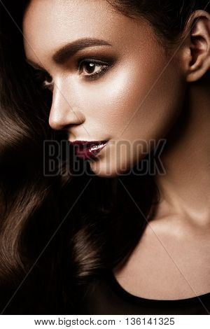 Glamour portrait of beautiful woman model with fresh daily makeup and romantic wavy hairstyle. Fashion shiny highlighter on skin, sexy gloss lips make-up and dark eyebrows poster
