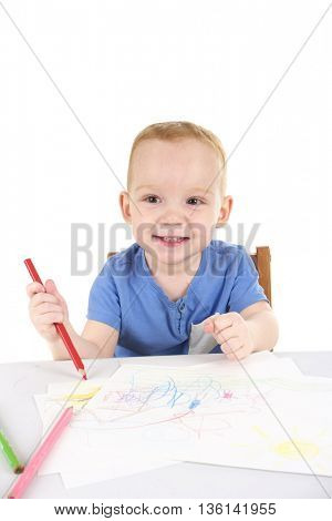 Little boy is drawing the picture