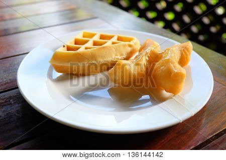 waffle and deep-fried dough on the plate in the table