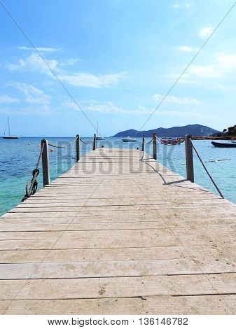 Wooden Gangplank or boardwalk into the sea. Pier or jetty.