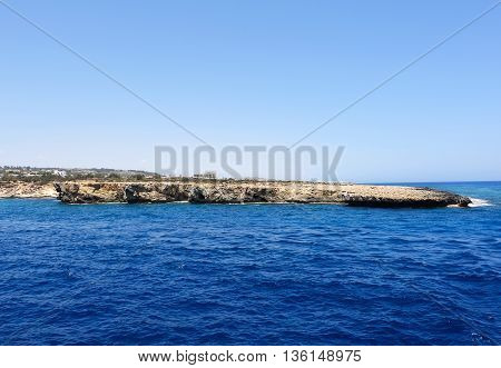 Photo of blue sea and rocks in protaras paralimni cyprus island.