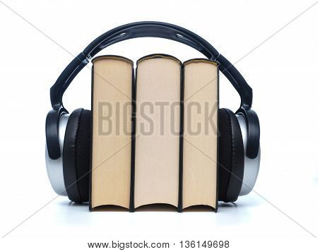 Three books with headphones audiobooks concept on white