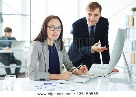 Portrait of business couple working in team