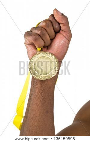 Athlete holding gold medal after victory on white background