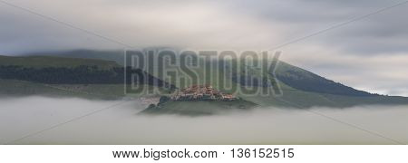 Castelluccio city in Italy during early morning fog