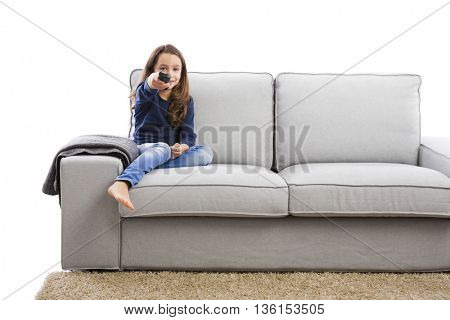 Little girl holding a TV remote control