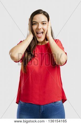 Happy woman covering her ears with hands