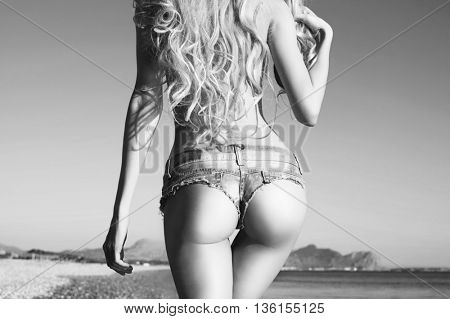 Beautiful slender blonde at the sea. Summer travel photos