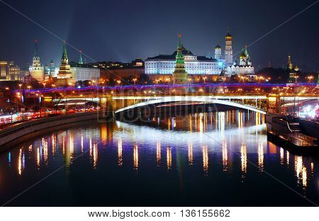 Moscow Kremlin. Night scene. The Moscow river embankment. The bridge over the river is decorated by lights in colors of Russian state flag - red blue and white. Moscow Kremlin is a UNESCO World Heritage Site.
