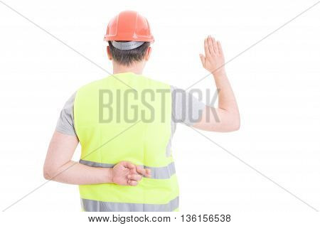 Young Constructor Taking Oath With Crossed Fingers Behind His Back