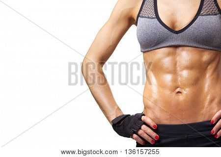 Cropped image of female model with muscular torso, isolated on white background