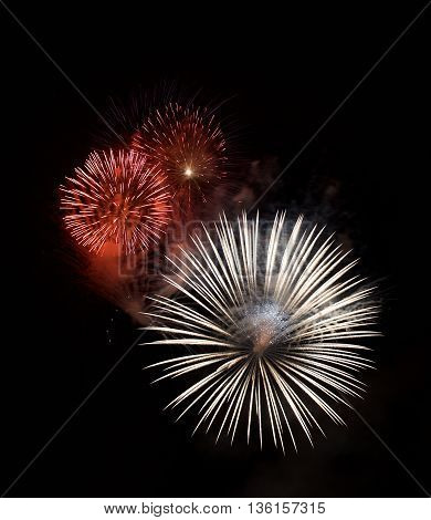 Colorful fireworks in dark background, orange red fireworks isolated in dark, colourful fireworks, New year, Christmas holidays, Independence day, explode, fireworks festival in Malta