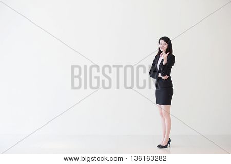 business woman show thumb up with white wall background great for your design or text asian