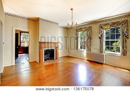 Cozy Empty Living Room With Fireplace And Hardwood Floor.