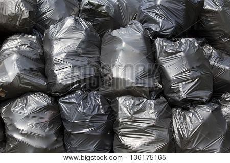 Black trash bags. A pile of black garbage bags.