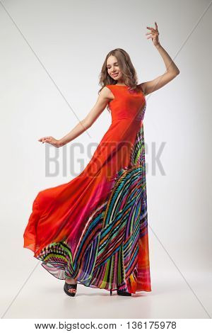 Portrait of smiling dancing fair-haired woman.Studio shot