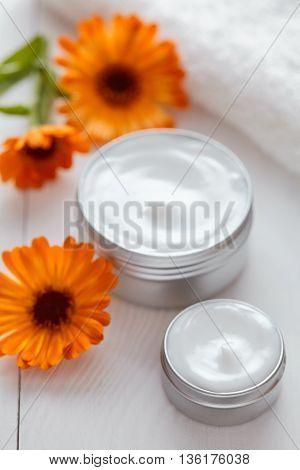 Yogurt cosmetic cream with calendula vitamin spa lotion natural organic herbal skin cleansing moisturizer product. Medical dermatology anti aging, acne, blemish, pimple, blackhead clear treatment