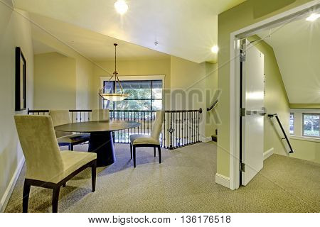 Image Of Upstairs Sitting Area In Soft Ivory With Black Table And Chairs.