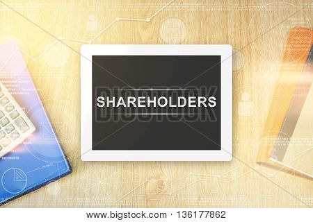 shareholders word on tablet with soft light vintage effect