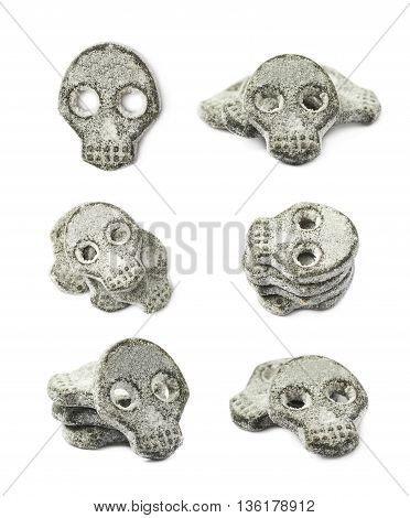 Skull shaped salt coated licorice candy isolated over the white background, set of six different foreshortenings