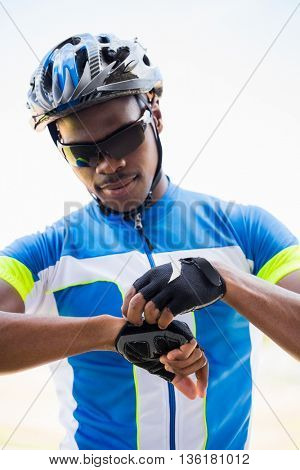 Close-up of athlete wearing cycling gloves