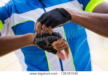 Mid section of athlete wearing cycling gloves