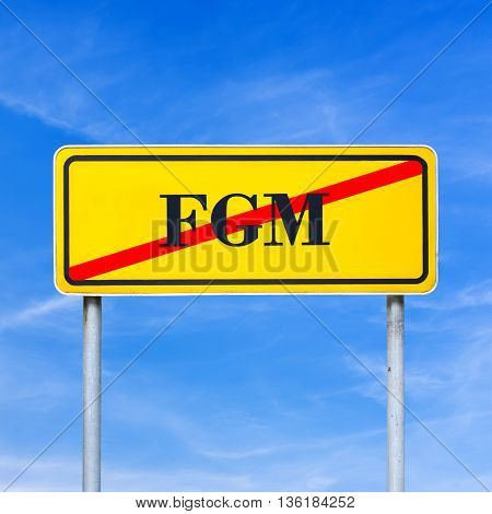 Conceptual image for protection of human rights - FGM abbreviation written on yellow street sign and crossed off over blue sky.