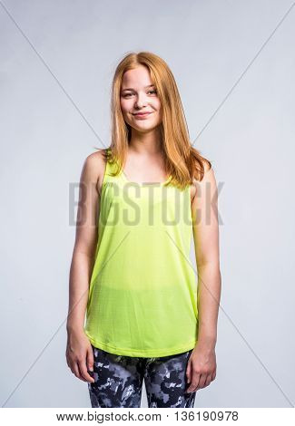 Girl In Yellow Singlet And Fitness Leggings, Young Woman, Studio