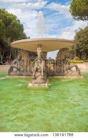 Rimini, Italy - Circa August 2013: Fountain of Four horses in Federico Fellini park at sunny summer day.