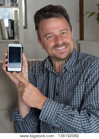 Man Surfing Net And Text Messaging With Mobile Phone