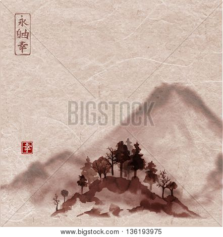 Landscape with mountains and trees, hand drawn with ink on vintage background. Traditional Japanese ink painting sumi-e. Contains hieroglyph - happiness, luck, zen, freedom, harmony.