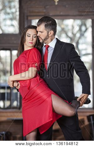Sensuous Partners Performing High Leg Wrap In Restaurant