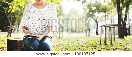 Woman Writing Environmental Park Relaxation Concept