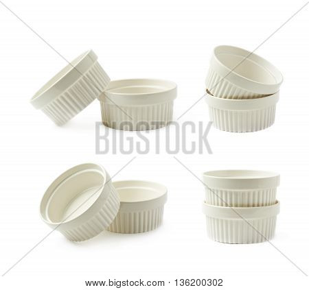 Two white porcelain souffle ramekin dishes, composition isolated over the white background, set of four different foreshortenings