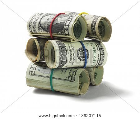 Stack of Rolled Up US Dollar Bills on White Background