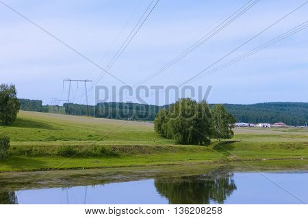 Supports High-power Transmission Lines And Five Hundred Thousand Volts (500) Leading Across The Rive
