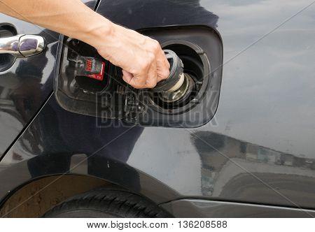 Hand opening the oil filler cap. cap, car, gas, service, hand,