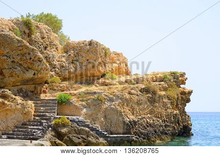 Rocks on the coast of Cretan Sea near Hersonissos Crete Greece.
