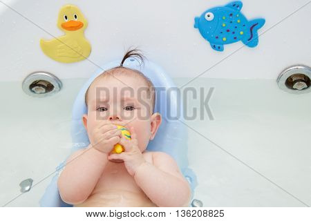 Newborn baby bathe and swim in a large tub