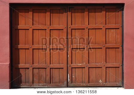 Red and Brown Garage door with a Latin American Style